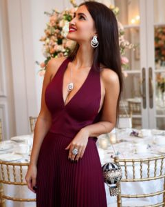 Alina Blinova wearing de Grisogono High jewellery, Judith Leiber Couture bag
